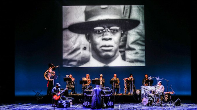 """A photograph from the collection of Gene Alexander Peters showing James Reese Europe in uniform is displayed during the concert """"James Reese Europe and the Harlem Hell Fighters: The Absence of Ruin."""" (Courtesy photo)"""