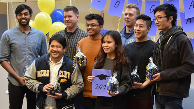 Eight of the nine data science majors who graduated December 15 gathered in the Division of Data Sciences on December 14 to celebrate their achievement. From left: Jeevan Reddy Mokkala, Emanuel Lucban, Adam Osborn, Nikhil Krishnan, Thao Vo, Alexander Ivanoff, Liam Shi and Howe Cui. Not pictured: Ting Chih Lin.