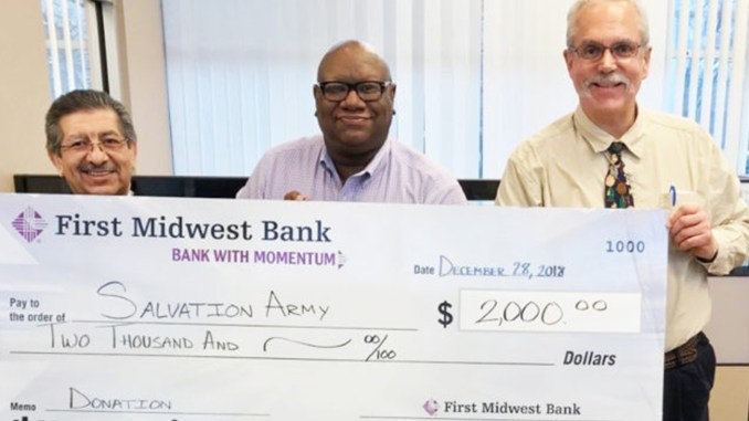 The Salvation Army in Northwest Indiana recently received a donation from First Midwest Bank in Hammond. Pictured holding the donation check from l-r: The Salvation Army Major Jose Tamayo, First Midwest Branch Manager Charles Reese, and The Salvation Army Director of Development Kevin Feldman.