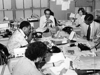 Employees working in an office at the headquarters of the Afro American Newspapers in Baltimore, Maryland, 1975. (Photo by Afro American Newspapers)
