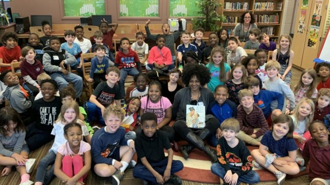 James Simons Elementary students with April Harrison. (Photo by: charlestonchronicle.net)
