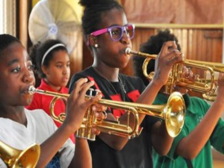 Students at Betty Shabazz International Charter Schools hone their music skills. (Photo by: chicagocrusader.com)