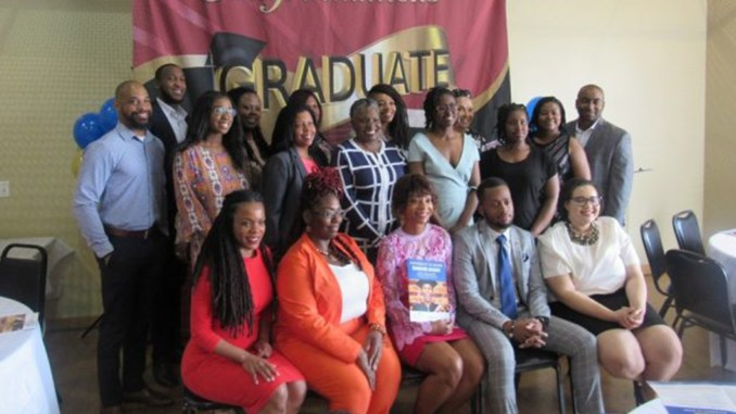 "Seven people received certificates from the AmeriHealth Caritas District of Columbia ""Pathways to Work"" program on April 9. Here graduates, mentors and supervisors pose for the happy occasion. (Photo by George Kevin Jordan)"