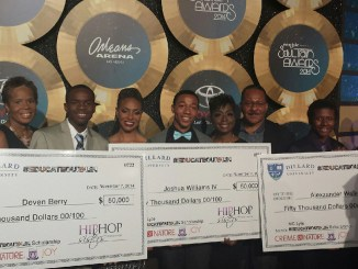 MC Lyte stands with scholarship recipients/ Courtesy Hip Hop Sisters Network