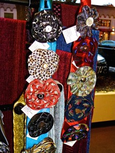 Upcycled Silk Flower Pins by Paula Dennis and backdrop Chenille Scarves by Gloria Miler