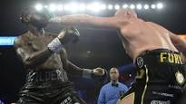 Tyson Fury Hands Deontay Wilder his First Loss with 7th Round TKO