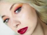 Blonde girl wearing orange, pink and blue eyeshadow with magnetic eyes sass lashes