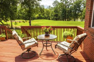 Adding some cozy furniture is a great way to upgrade your deck!
