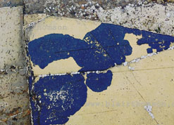 marks, calligraphic, rock signs perhaps, ochre with dark blue black shapes