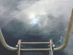 transparent water, sun reflecting or the moon with a ladder reaching down