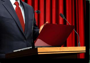 Man at podium giving presentation