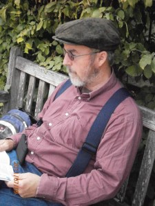 Photo of man reading on bench