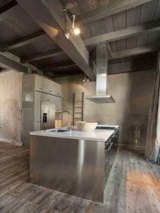 reforma-cocina-casa-rural-reformada-isla-central-modulo-adicional-muebles-acero-inoxidable-suelo-parquet