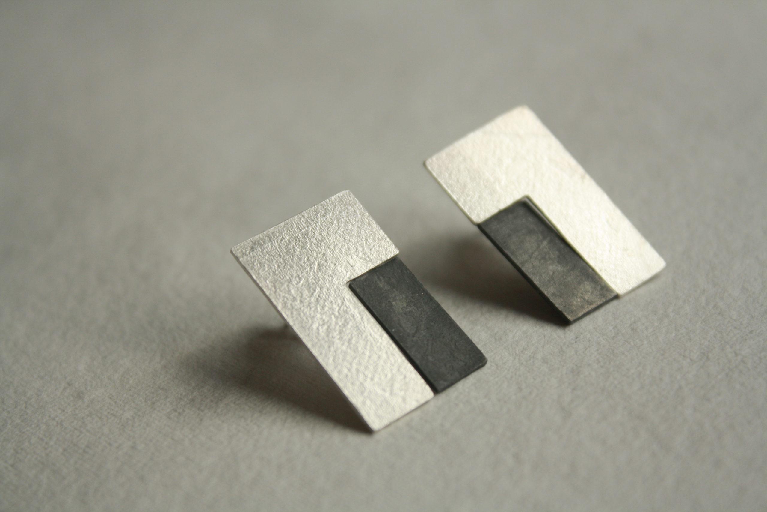 Pendientes rectangulares de plata con movimiento artesanales