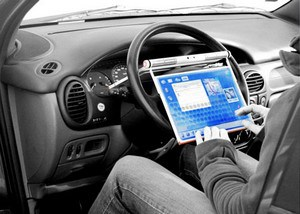 Steering wheel mounted laptop