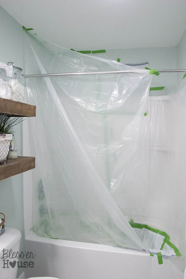 Here is how to cover your entire shower with a drop cloth to avoid any major mistakes or messes! How to Spray Paint Shower Fixtures (without the plumbing work)   Bless'er House