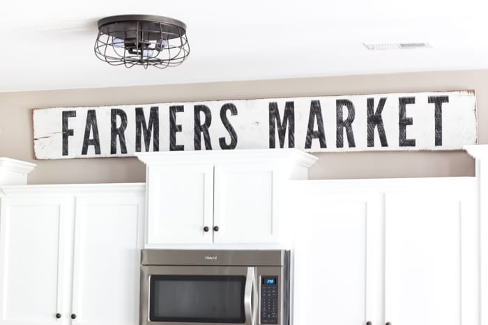 How to Make Farmhouse Signs the Easy Way | blesserhouse.com - A full detailed tutorial for how to make farmhouse signs the easy way using just wood, paint, an Xacto knife, and a computer printer.