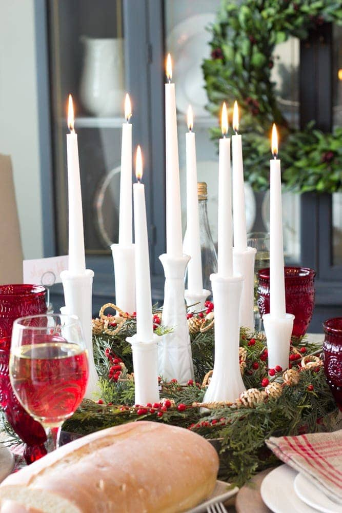 Thrifty Christmas decorating idea: Put candles in old bud vases for a simple centerpiece