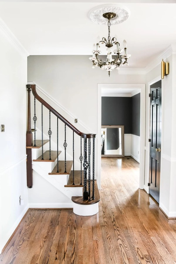 Neutral Painted Foyer Update | Blesserhouse.com - A drab, dated foyer and staircase get a bright, neutral facelift with high contrast details using Benjamin Moore colors Classic Gray and Wrought Iron.