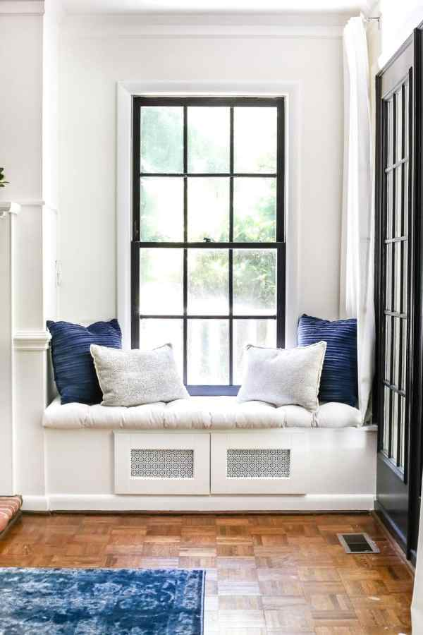 Tried and true ways to decorate and refresh your home completely for free (and maybe even make a little money in the process). #decorating #homedecor #budgetdecor Living room window seat to house TV electronics
