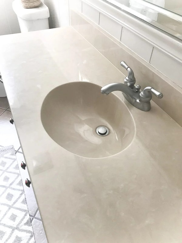 DIY Painted Bathroom Sink Countertop | blesserhouse.com - An 80s beige cultured marble sink and countertop get a bright white makeover using super durable paint meant specifically for sinks, tubs, and showers