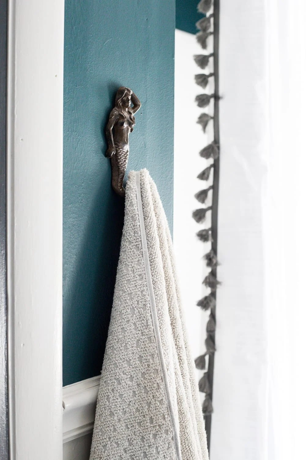 kid-friendly home - hooks for hanging up towels easily in the bathroom