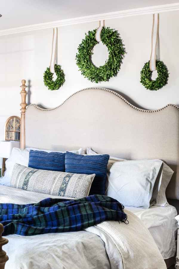 Blue Christmas Bedroom | blesserhouse.com - A master bedroom decorated for Christmas with neutrals, blues, and greens that transitions easily into winter. #christmasbedroom #bluechristmas