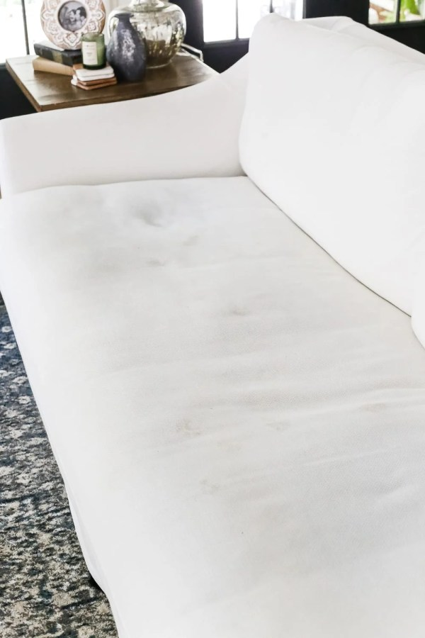 A complete review the IKEA Farlov sofa- how it holds up after 8 months with 2 dogs and a preschooler, the pros and cons of owning one, and tips to keep it looking bright white. #sofa #ikea #farlov #slipcover #furniture #livingroom