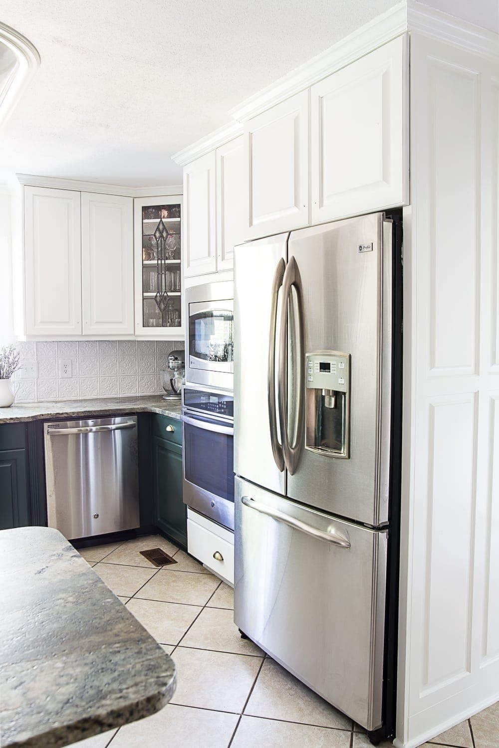 white upper and green lower kitchen cabinets stopping at wall oven & refrigerator