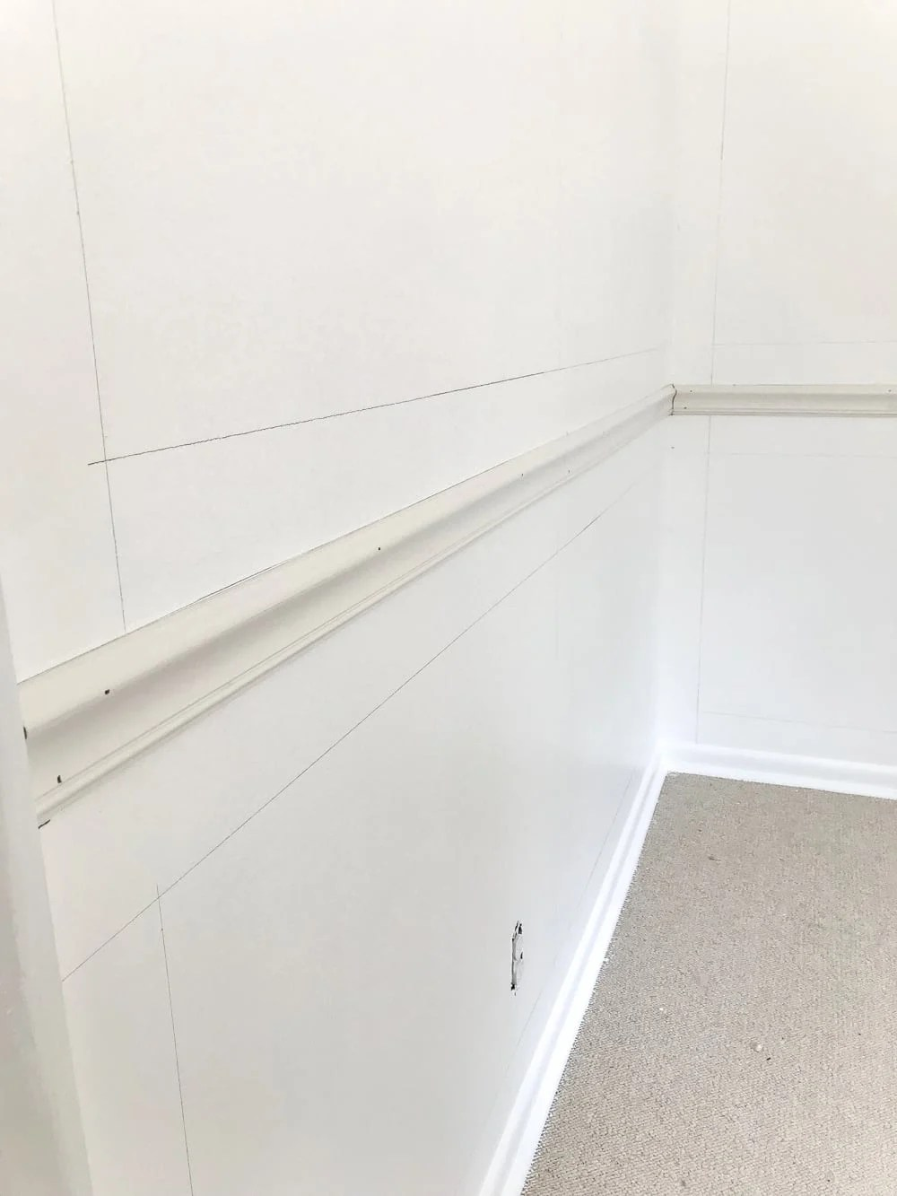 """mark walls for picture frame molding using a 4"""" board as a spacer"""