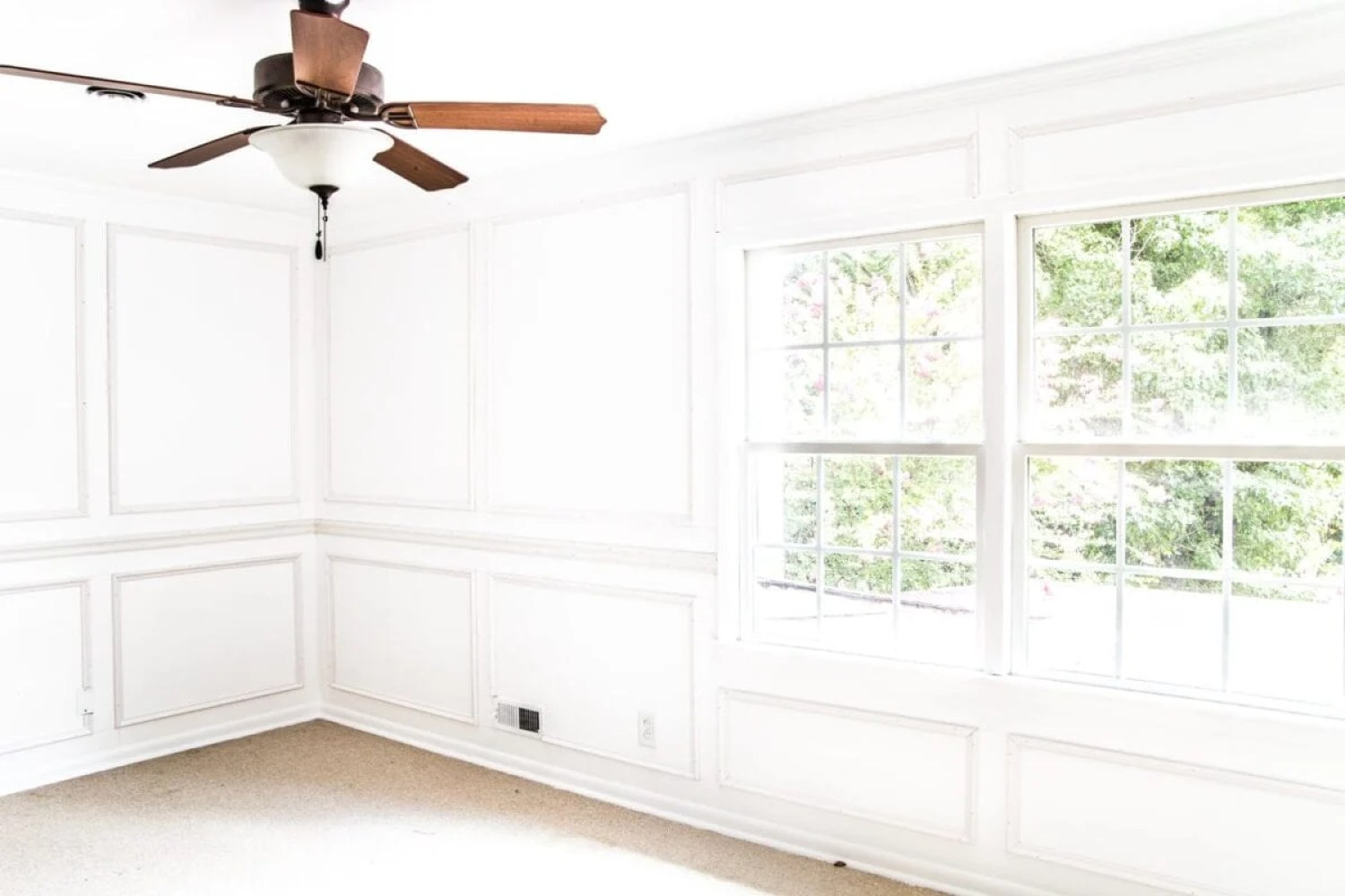 A step-by-step tutorial for hanging picture frame molding wainscoting and a shortcut to make it easier.