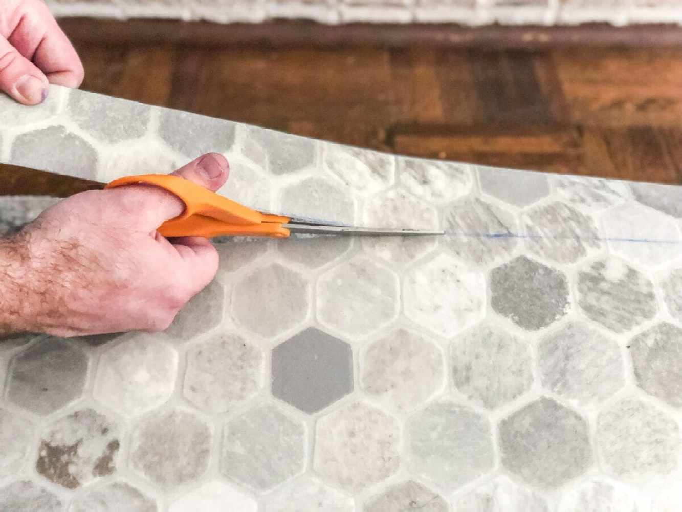 How to install sheet vinyl flooring over old tile | Cut out your template