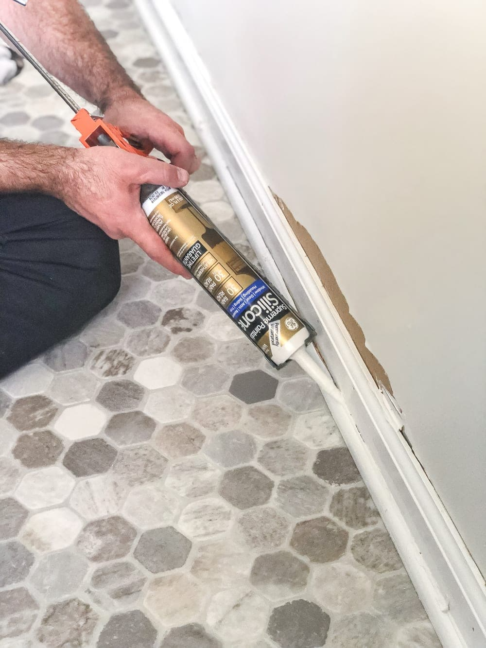 How to install sheet vinyl flooring over old tile | use silicone caulk on moulding