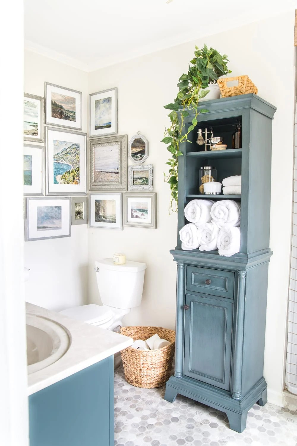 Budget Master Bathroom Refresh Reveal | corner gallery wall with thrifted frames and free coastal art printables and linen cabinet