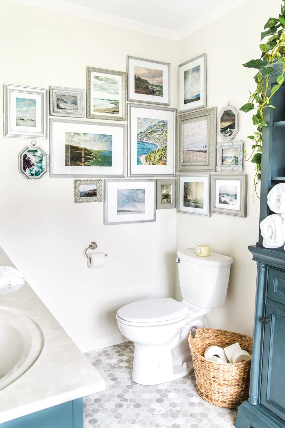 A corner wall art display as bathroom decor