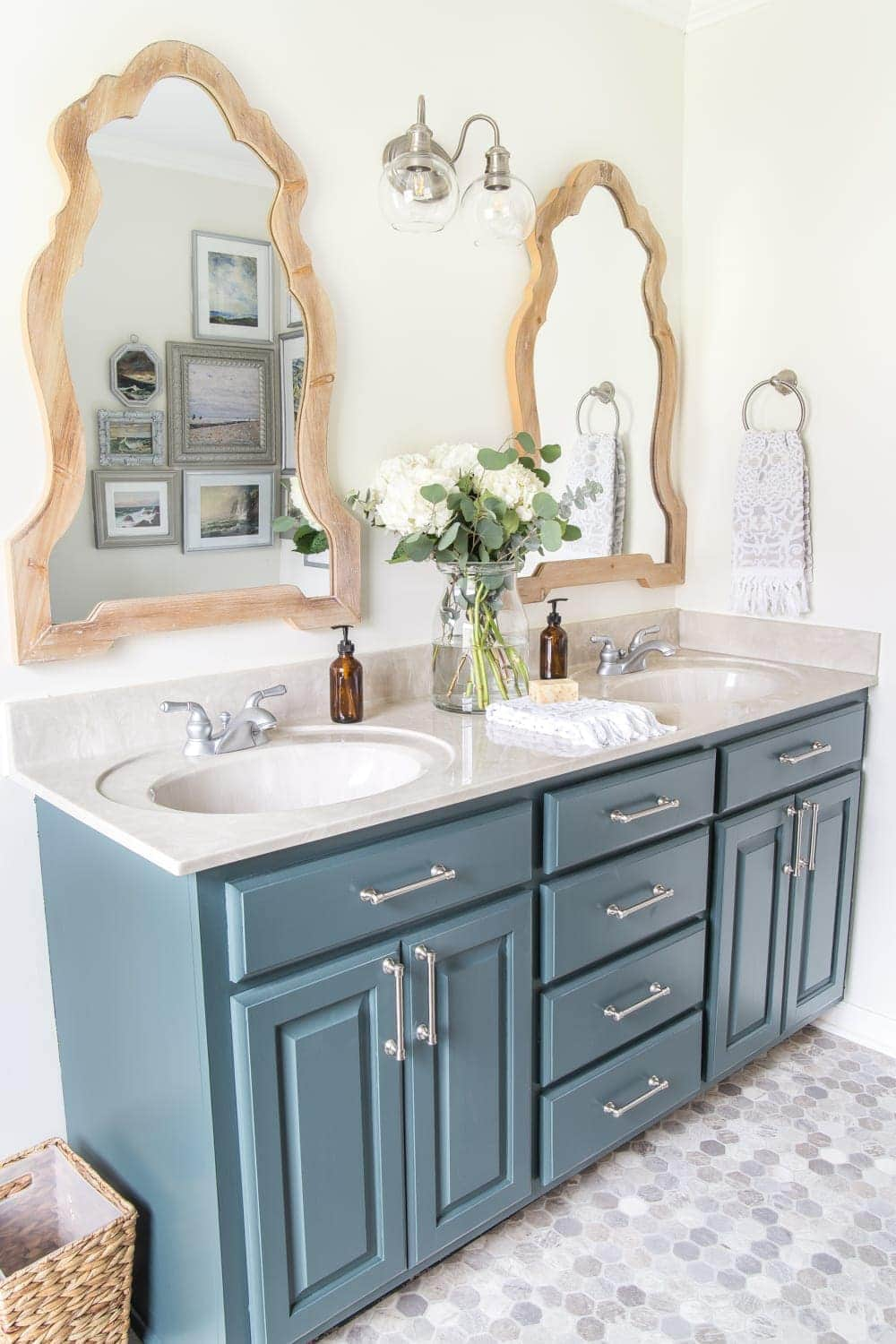 Budget Master Bathroom Refresh Reveal | Vinyl hexagon tile floor, wooden arch mirrors, and DIY painted vanity