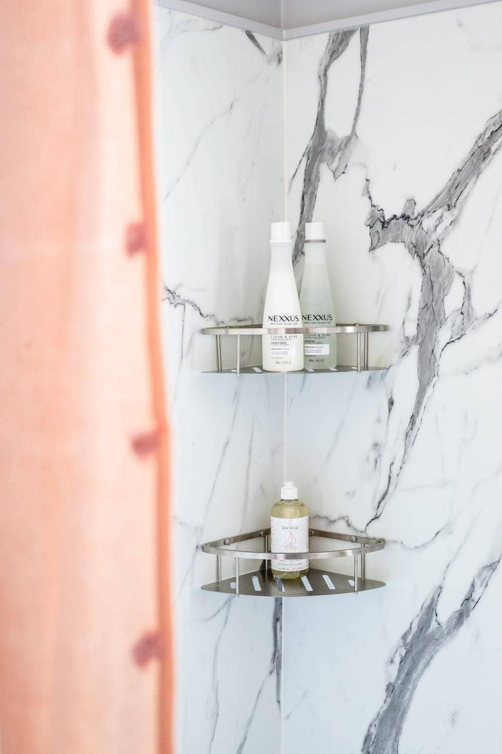 Whimsical, classic kids bathroom makeover   faux marble shower walls