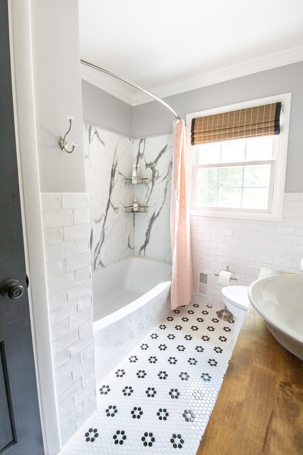 Whimsical, classic kids bathroom makeover | faux marble shower with American Standard Passage Collection and retro tile floor