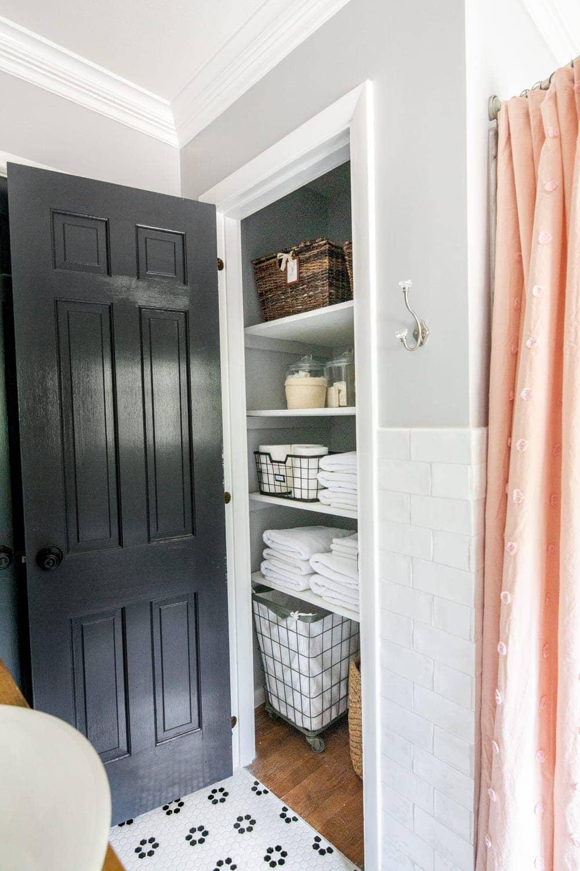 Whimsical, classic kids bathroom makeover   linen closet organization
