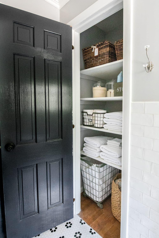 Girls' Bathroom Decor Details & Sources | organized bathroom linen closet