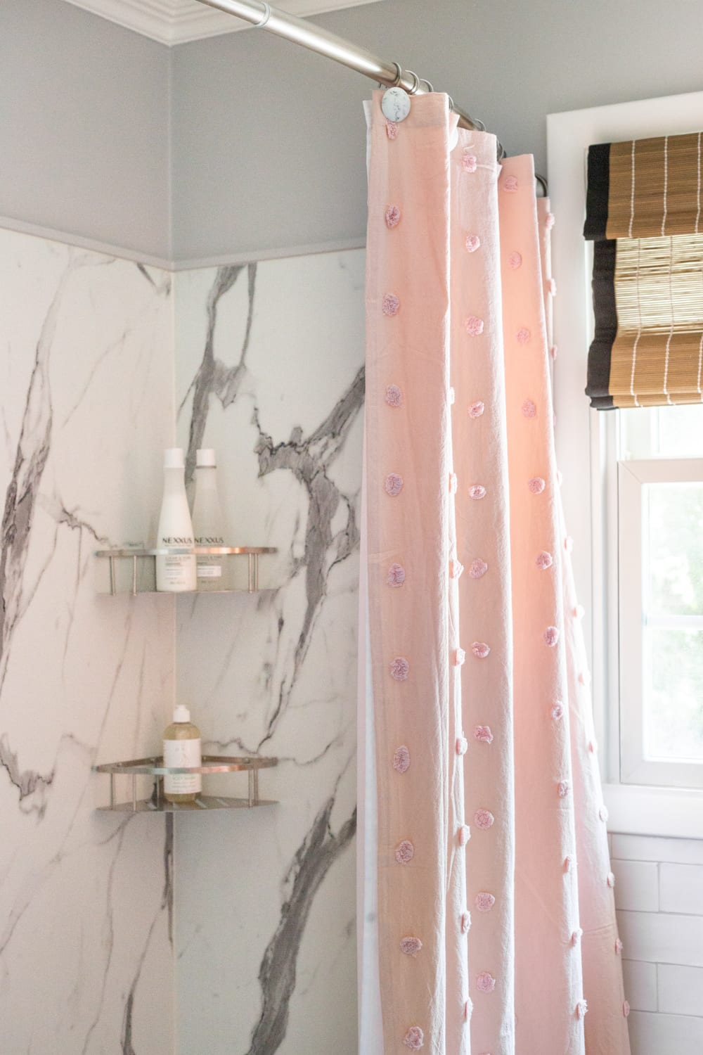 Girls' Bathroom Decor Details & Sources | Faux marble shower walls from American Standard Passage Collection