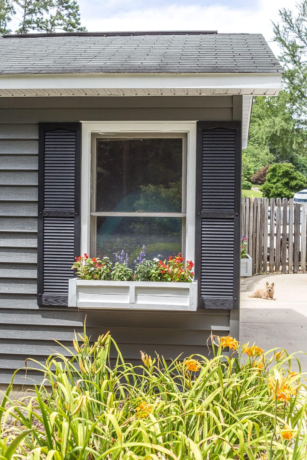 How to paint vinyl siding & DIY window box from scrap wood | Sherwin Williams Pepper Shake charcoal gray exterior