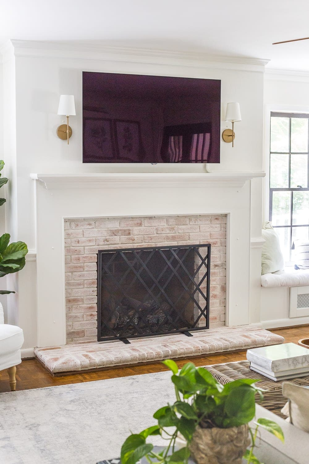 Keep your mantel simple and minimalist with just a pair of sconces on either side of your TV.