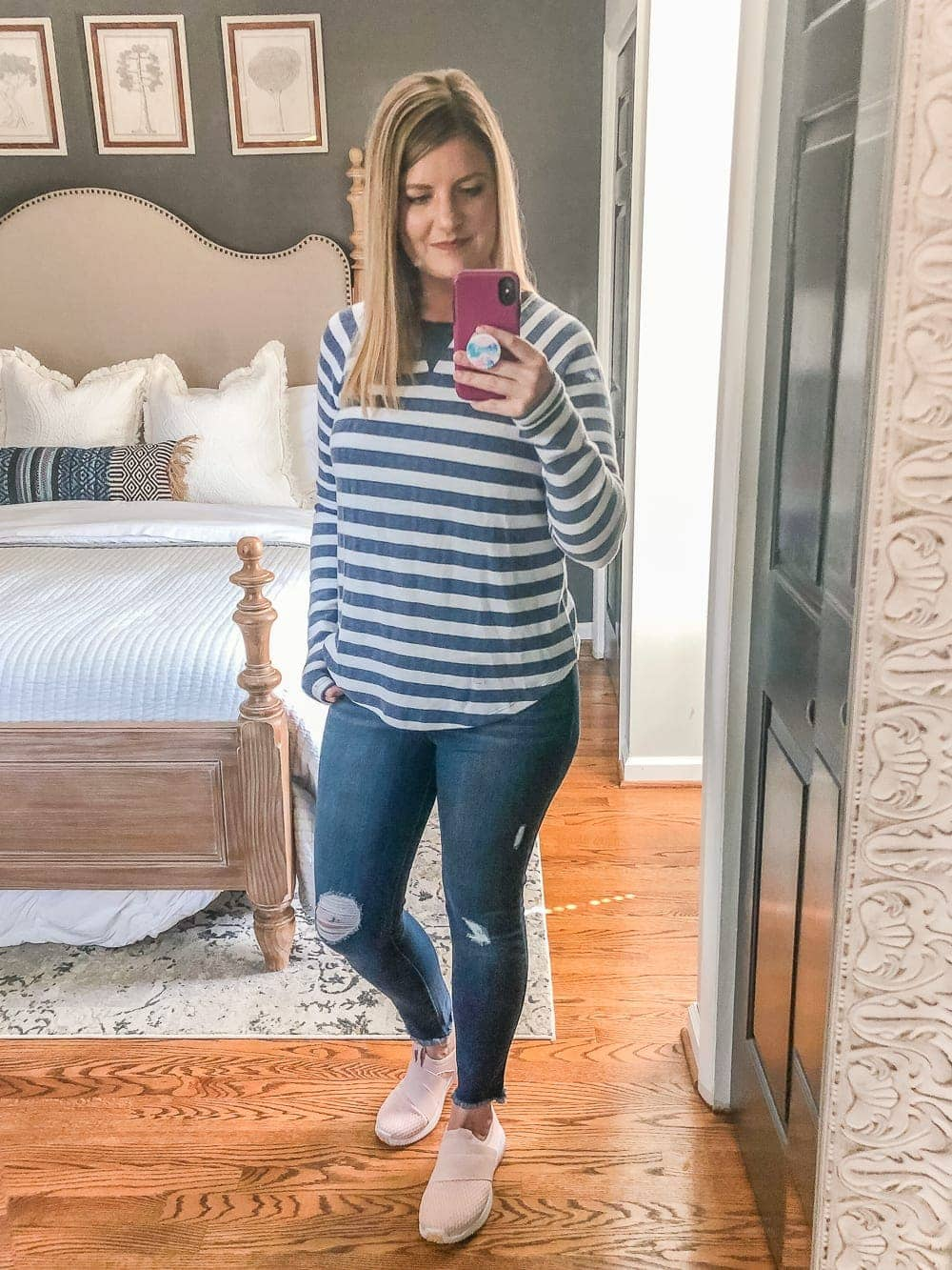 7 Inexpensive Tummy Hiding Mom Friendly Fall Outfits - Pullover shirt, distressed jeans, and slip-on sneakers
