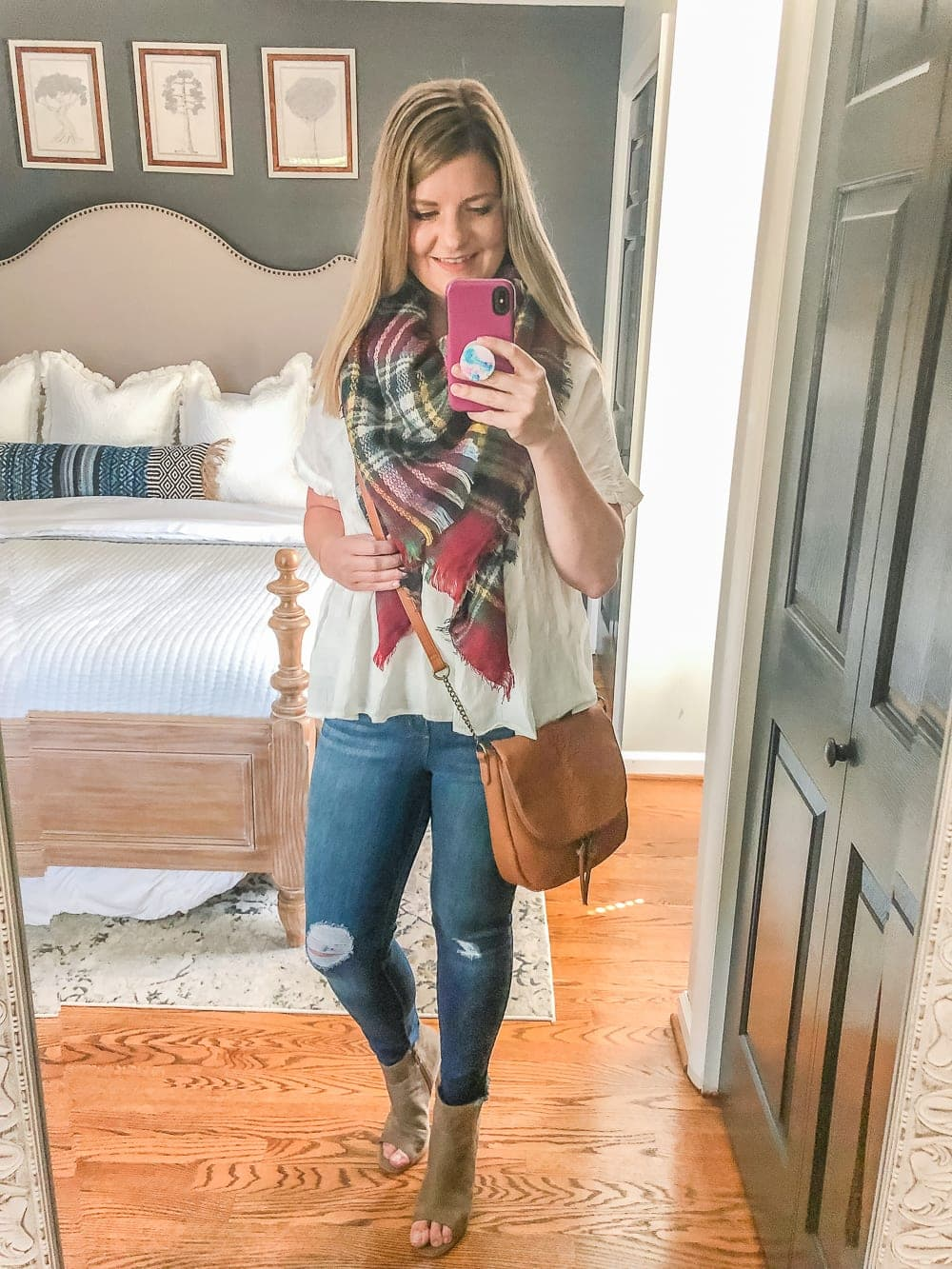 7 Inexpensive Tummy Hiding Mom Friendly Fall Outfits - flowy peplum blouse, plaid scarf, cognac crossbody bag, distressed jeans, peep toe booties