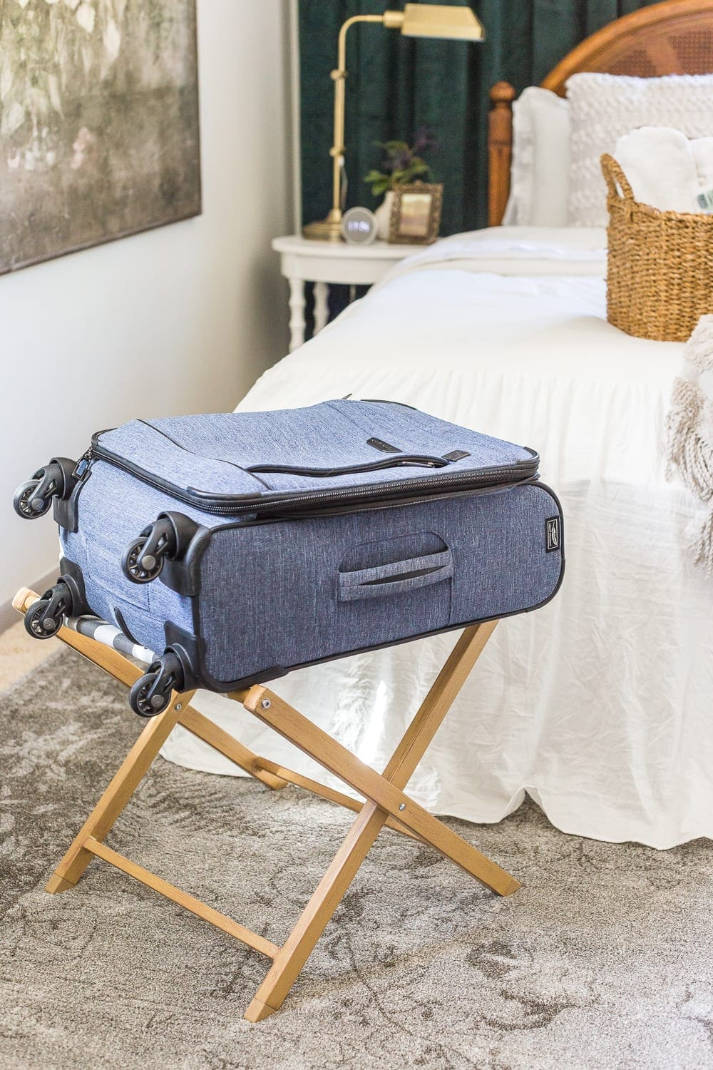 38 Guest Bedroom Essentials | Have a luggage rack so guests have a place to stow their suitcase.