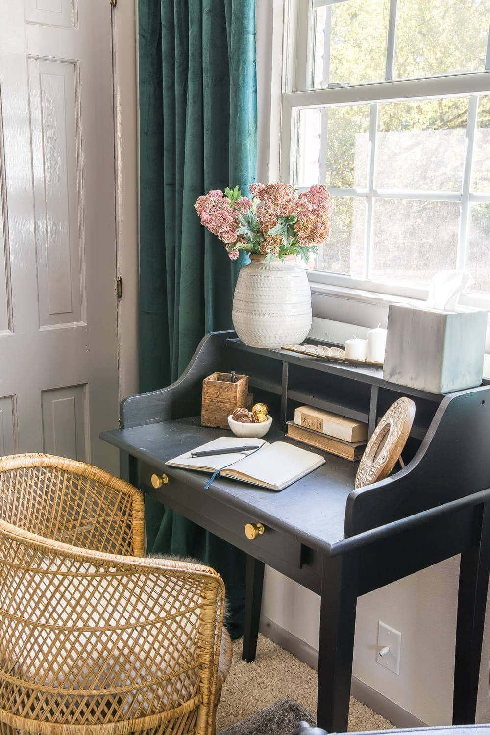 38 Guest Bedroom Essentials | Have a small desk / vanity area with a mirror so that guests have a place to get ready if other people need to get in the bathroom.