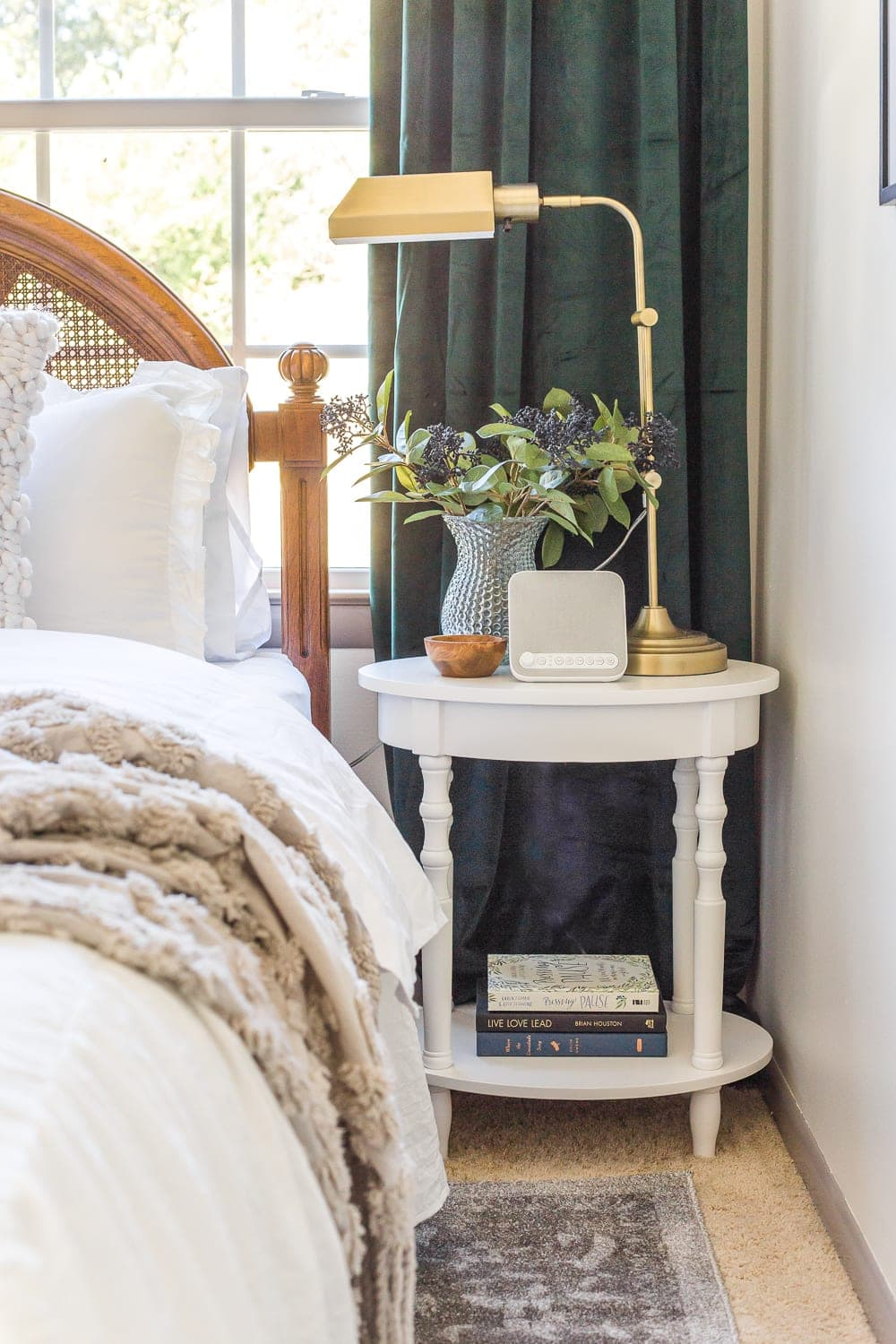 38 Guest Bedroom Essentials | Have a bedside table with good light and a few favorite books.