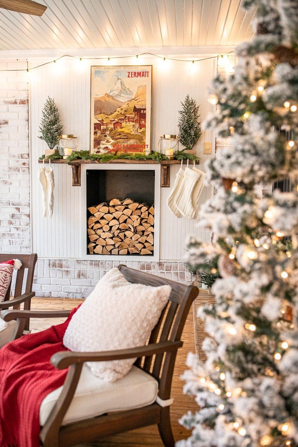 Faux fireplace with wood stack and cozy Christmas decor
