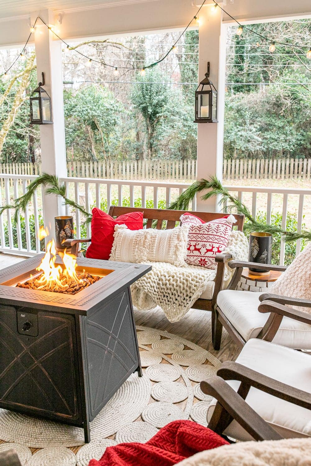 Cozy Christmas back porch with traditional red and green colors and cozy throw pillows and blankets